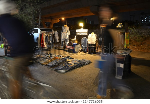 Bangkok, Thailand- January 30, 2016: A vintage style store selling jeans named Patchwork on a shopping area road called Siam Gypsy night market. Focused on the jean store with blurry and moving people