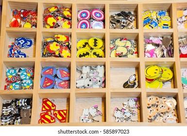 BANGKOK THAILAND â?? January 30 2017 :  Colorful  of metal bead block letter, bell cartoon shape and cartoon locket to handmade beautiful  bracelet ornaments at the shop in Bangkok of Thailand.