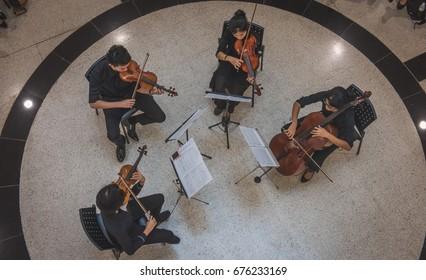 BANGKOK, THAILAND - January 30, 2017: A string quartet, play classical music, at the Bangkok Art and culture center.