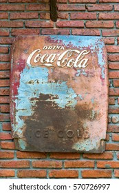 Bangkok, Thailand - January 30,2017 : The old rust condition vintage of Coca Cola sign on the brick wall