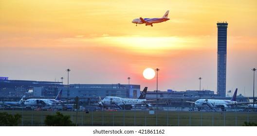 BANGKOK THAILAND -January 30,plane landing to runways at suvarnabhumi international air port in sunset on January 30, 2016 in Bangkok, Thailand.