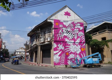 BANGKOK, THAILAND - JANUARY 31, 2016: A mural artwork on a building exterior of  the Chinese style shophouse by Aitch, a Romanian street artist, which is part of the Bukruk II Urban Arts Festival.