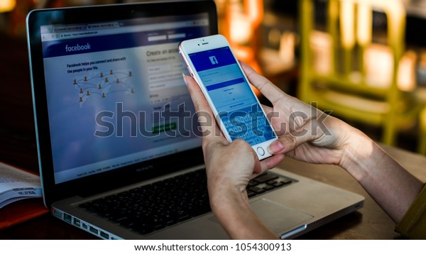 Bangkok. Thailand. January 31, 2018. A woman holds Apple iPhone 7 with facebook application on the screen.facebook is a photo-sharing app for smartphones.