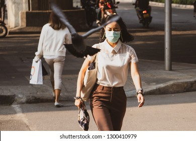Bangkok, Thailand - January 31, 2019 :Thailand people wearing mouth mask against air smog pollution with PM 2.5 walking on street at chatuchak district in  Bangkok city, Thailand.