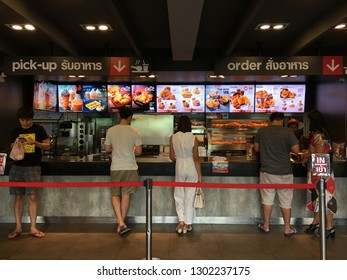 BANGKOK, THAILAND, JANUARY 31, 2019 - People are standing and waiting, queuing for order some food and make payment in KFC restaurant at the Motorwayt of Bangkok- Chon Buri before travel in holiday.