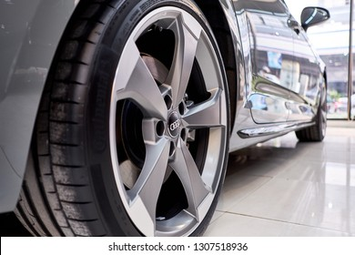BANGKOK, THAILAND - JANUARY 31, 2019: close up of 5 spoke design Audi Sport alloy wheels with titanium look matt finish with Continental tyres.