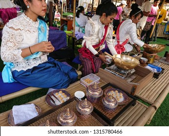 Bangkok, Thailand. January 4, 2019 - thai ladies are preparing thai dessert, jamongkut in new year festival near Dusit palace, Bangkok. thai traditional food concept.