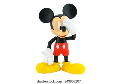Bangkok, Thailand - January 6, 2015: Mickey Mouse action figure the official mascot of The Walt Disney Company. Mickey Mouse is a funny animal cartoon character was created by Walt Disney.