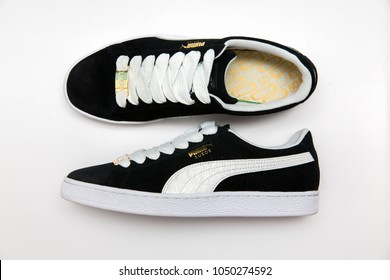BANGKOK, THAILAND - JANUARY 6, 2018 : The Puma suede a street legend, established 1968, reimagined 2018 on white background.