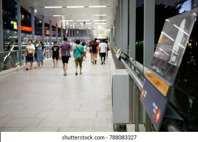 BANGKOK, THAILAND - JANUARY 6, 2018: Many people are walking on the Ratchaprasong skywalk that connects a large shopping mall district in Bangkok, Thailand.
