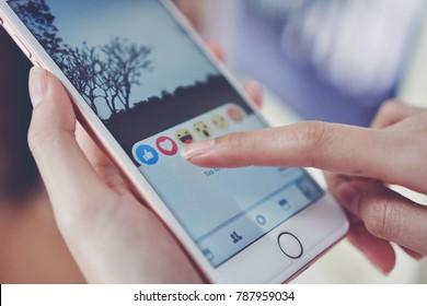 Bangkok, Thailand - January 7, 2018 : hand is pressing the Facebook screen on apple iphone6 ,Social media are using for information sharing and networking.