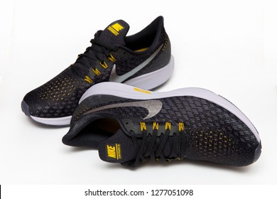 BANGKOK, THAILAND - JANUARY 7,2019 :Nike Air Zoom Pegasus 35 Men's Running Shoes BLACK/MTLC PEWTER color isolated on white background. Nike is a global sports clothes and running shoes retailer