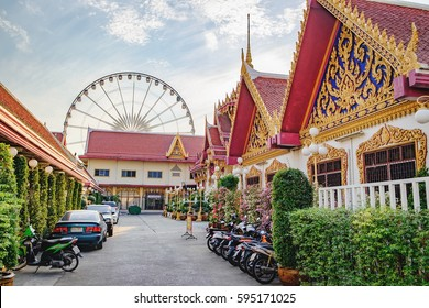 Bangkok, Thailand - January 9, 2016: Wat Ratcha Singkhorn - last stop of Express Boat with Orange Flag. Asiatique Ferris Wheel in background. Asiatique is largest lifestyle shopping mall in Bangkok