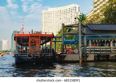 Bangkok, Thailand - January 9, 2016: Oriental Pier is the first pier of Chao Phraya Express Boat, popular boat travel and tourist attractions on both sides of the river. CAT Tower is in the background