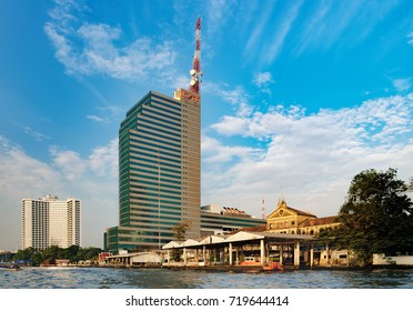 Bangkok, Thailand - January 9, 2016: Wat Muang Kae is the pier of Chao Phraya Express Boat, popular boat travel and tourist attractions on both sides of the river. CAT Tower is in the background