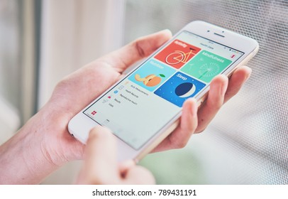BANGKOK ,THAILAND - January 9, 2018 : women holding smartphone on the Health app screen on iPhone 6. is an application for iOS 11 which monitor the fitness data of the user.