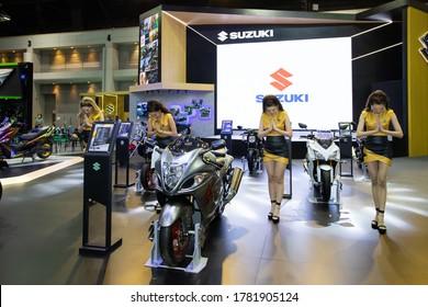 Bangkok, Thailand, Jul 15, 2020 - Suzuki motorcycles booth and group of pretty Asian models introducing the motorcycle in Bangkok Motor Show 2020