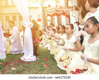 BANGKOK, THAILAND - JUL 18, 2017 : Eucharist ceremony of Christianity and The girls dressed in white dresses. Help to sow flowers in ceremony at Church of Saint Paul in Bangkok, Thailand
