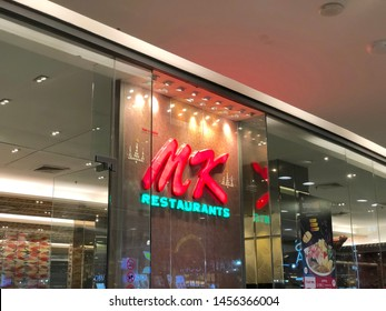 Bangkok, Thailand - JUL 19, 2019 : Label of MK Restaurants at CentralPlaza Grand Rama 9 at night.Signpost to MK restaurants.Notice of Sukiyaki.Tablet of Sukiyaki.Red text infront of resturant.