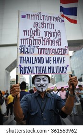 BANGKOK, THAILAND - JUL 21, 2013: Nationalist protesters march on a city centre street during an anti government rally. The protesters call for the government to be overthrown.