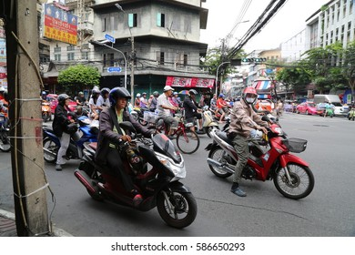 Bangkok, Thailand - July 1, 2014:Motorcycle wait to go at intersection with traffic light on a road.
