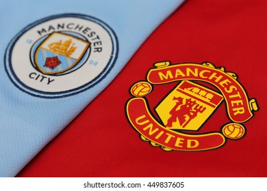 BANGKOK, THAILAND - JULY 10, 2016: The  Logo of Manchester United and Manchester City  on Football Jerseys on July 10,2016 in Bangkok Thailand.