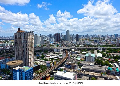 BANGKOK, THAILAND - JULY 10, 2016: Panoramic view from the East of Bangkok downtown cityscape during the bright sunny day showing large span of high rise buildings across the skyline.