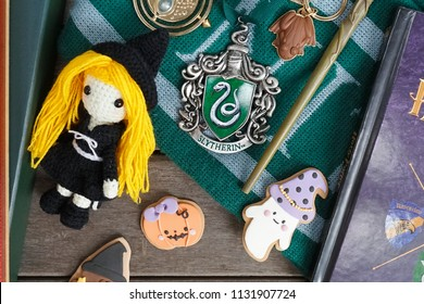Bangkok, Thailand - July 11, 2018 : A photo of merchandise from Harry Potter movies with selective focus on the Slytherin Crest metal ornament. Slytherin is 1 of the 4 houses in Hogwarts school.