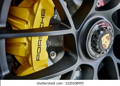 BANGKOK, THAILAND - JULY 11, 2018: Porsche 911 Carrera 4 GTS rims and ceramic break. Close up of wheel with a logo and yellow caliper of ceramic breaking system after polishing & coating.