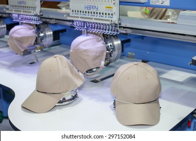 BANGKOK ,THAILAND - JULY 11: Cap on embroidery machine at Garment 