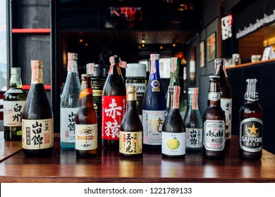 BANGKOK, THAILAND. JULY 12, 2016: Many major and minor brands of Japanese liquors are including beer, sake, spirits and umeshu in Japanese restaurant.
