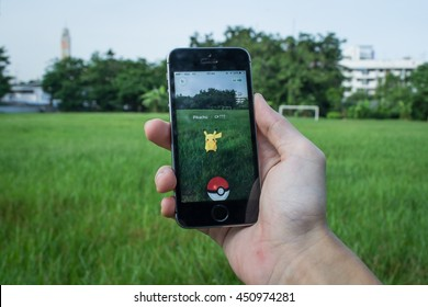 Bangkok, Thailand - July 12, 2016 : Apple iPhone5s held in one hand showing its screen with Pokemon Go application.