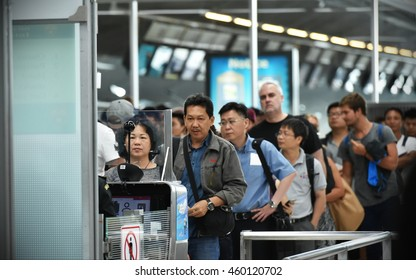 Bangkok, Thailand - July 12, 2016: Air travellers queue at immigration control at Suvarnabhumi International Airport. The Thai capital's SE Asia aviation hub handles 45 million passengers each year.