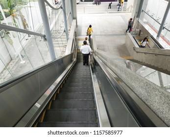 Bangkok, Thailand - July 12, 2018: Escalator stairs in MRT subway train station. Electric escalator take passengers up the MRT underground station in Bangkok capital city , Thailand