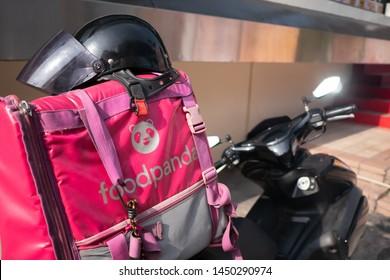 Bangkok, Thailand - July 12, 2019 : foodpanda logo on foodpanda rider's motorcycle bag.