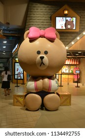 Bangkok, Thailand - July 13, 2018: Giant Size Choco (Bear) Doll in front of LINE Village Store at Siam Square One Shopping Center (the 1st Official LINE Store in Thailand).