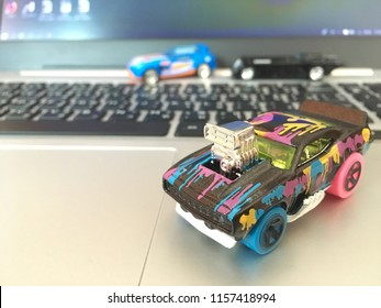 Bangkok, Thailand - July 13, 2018 :Hotwheels diecast model car on Computer Notebook.