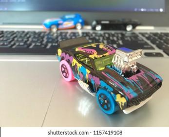 Bangkok, Thailand - July 13, 2018 :Hotwheels diecast model car on Computer Notebook.