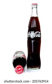 BANGKOK, THAILAND - JULY 14, 2014: Cold Classic Coke Botte on a white background