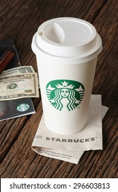 BANGKOK, THAILAND - JULY 15, 2015: White paper cup with Starbucks logo. Starbucks is the world's largest coffee house with over 20,000 stores in 61 countries.