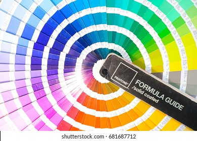 Bangkok, Thailand - July 15, 2017 : Color swatches book or Pantone color guide. Rainbow sample colors catalogue in many shades of colors or spectrum. With color code detail information. Editorial only
