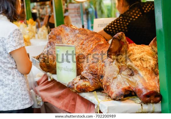 Bangkok, Thailand - JULY 15, 2017 :Grilled suckling pig (Thai text mean Trang's Province roast pork).Depth of field.