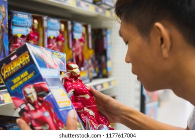Bangkok, Thailand - July 15, 2018: Young man holds a box with a model of Iron Man.