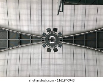 BANGKOK, THAILAND - JULY 16, 2018 ; I looked up to the ceiling of departure hall of Suvarnabhumi international airport and saw these uplight to the roof structure.