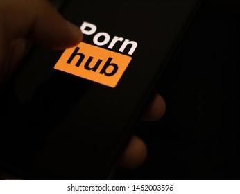Bangkok, Thailand - July 16, 2019 : Internet user Opening an application Pornhub on smartphone.