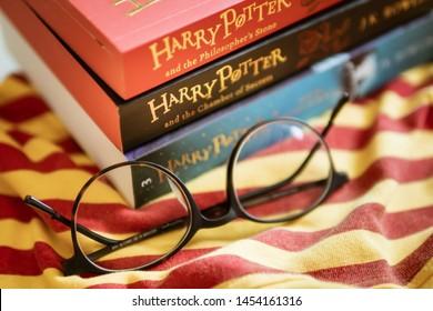 Bangkok, Thailand - July 16, 2019 : Harry Potter books with round shape eyeglasses.