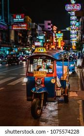 Bangkok, Thailand - July 17,2017; Famous moto-taxi called tuk-tuk is a landmark of the city and popular transport, Tuk tuk on the street in Chinatown, street food night market in bangkok thailand.