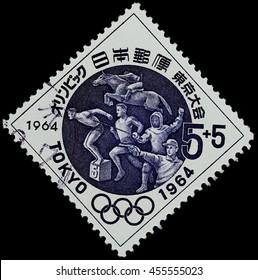 "BANGKOK, THAILAND - JULY 18, 2016: A postage stamp printed in Japan shows modern pentathlon sport, series ""Tokyo Olympic Games"", circa 1964."