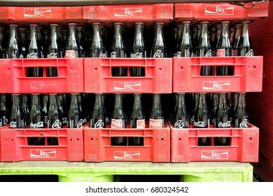 BANGKOK, THAILAND - JULY 18, 2017: Coca Cola Bottles on Truck, Coca-Cola is a carbonated soft-drink. It is produced by The Coca-Cola Company.