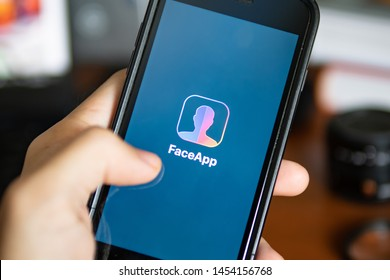 Bangkok, Thailand - July 18, 2019 : iPhone 7 showing its screen with FaceApp - AI Face Editor application.